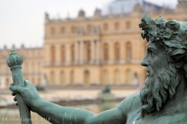 A bronze statue in the gardens of Versailles