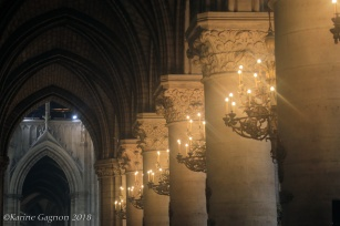 Massive pillars and candelabras inside Notre-Dame-de-Paris