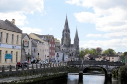 Saint Fin Barr Cathedral seen from a bridge spanning the River Lee